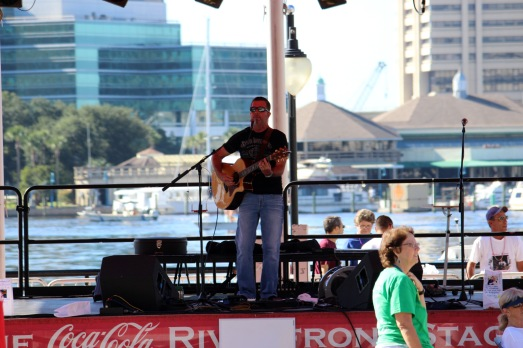 Singer Bill Rice performs at the Landing for the Out of the Darkness walk. (Photo By Savannah Dobbs)