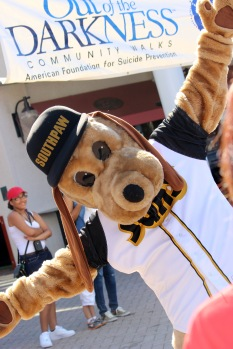 The Jacksonville Sun's mascot, Southpaw, offers support to attendees. (Photo By Savannah Dobbs)
