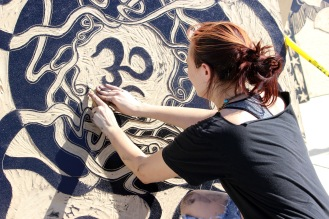 A student carving the finishing touches to her wood cut (Photo by Savannah Dobbs)
