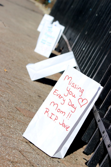 A row of luminaries stand in memory of sucide victims. (Photo By Savannah Dobbs)