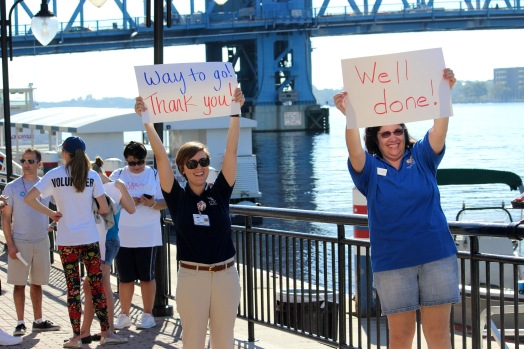Attendees cheer on walkers as they make their way back to the Landing. (Photo By Savannah Dobbs)