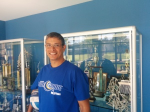 Volleyball coach José Rivera leads the Blue Wave on the chase for trophies.