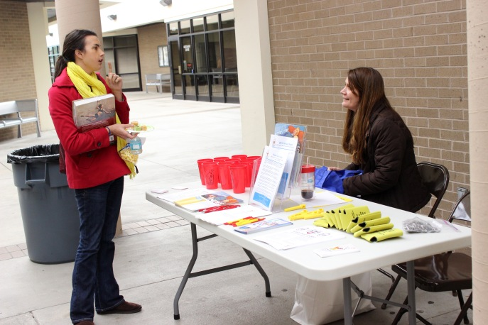 A student speaks with a representative from the Ronald McDonald House. (Photo By Savannah Dobbs)