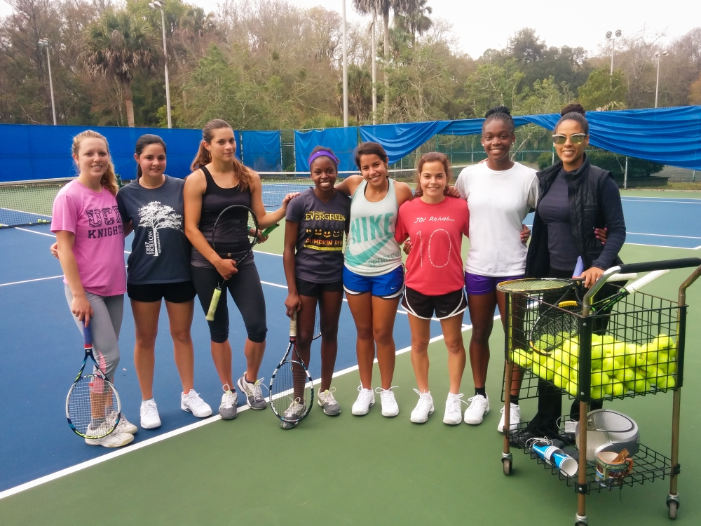 Members of the Blue Wave tennis team pose. left to right: Shannon Donaldson, Krista Tyson, Efrosina Kariqi, Kami Thomas, Michelle Chemaly, Thais Castiglioni, Olivia Rolle, coach Sabaea Carrington. (Photo By Clayton Freeman)