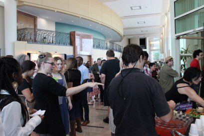 Attendees make their way to the South Gallery opening after recognizing the winners of the 2015 Student Annual Juried Exhibit. (Photo by Savannah Dobbs)