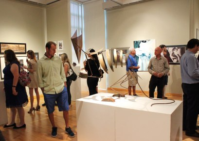 A man gazes at one of the student works on display in the South Gallery. (Photo by Savannah Dobbs)