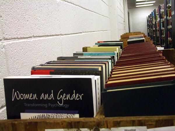 Rows of books stretch back to the rear of the South Campus library. (Photo by Craig Young)