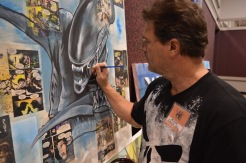 Artist Chris King paints at Ancient City Con. (Photo by: Alvin Ogando)