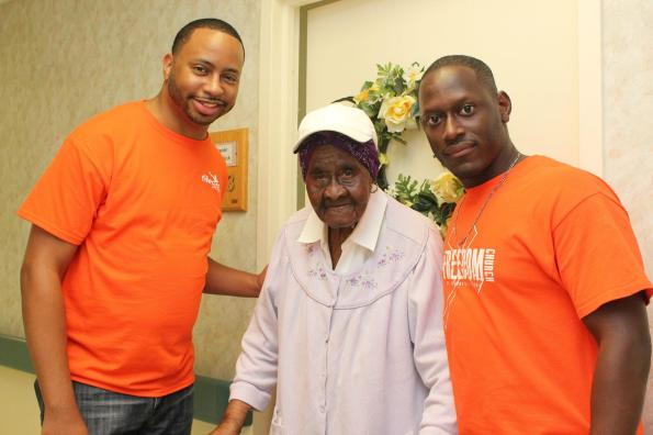 Pastor Rawls with resident at Taylor Homes