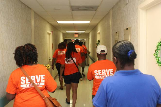 Serve Team going room to room at Taylor Home