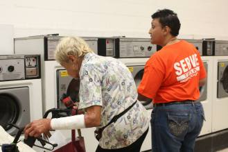 Serve Team member assisting customer with laundry