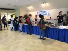 The students lining up to try the international food provided by the school