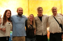 Artists M.J. Hinson, Isaac Brown, Liz Bryant, and Patrick Miko pose for a group photo with Professor Charlie Philips.